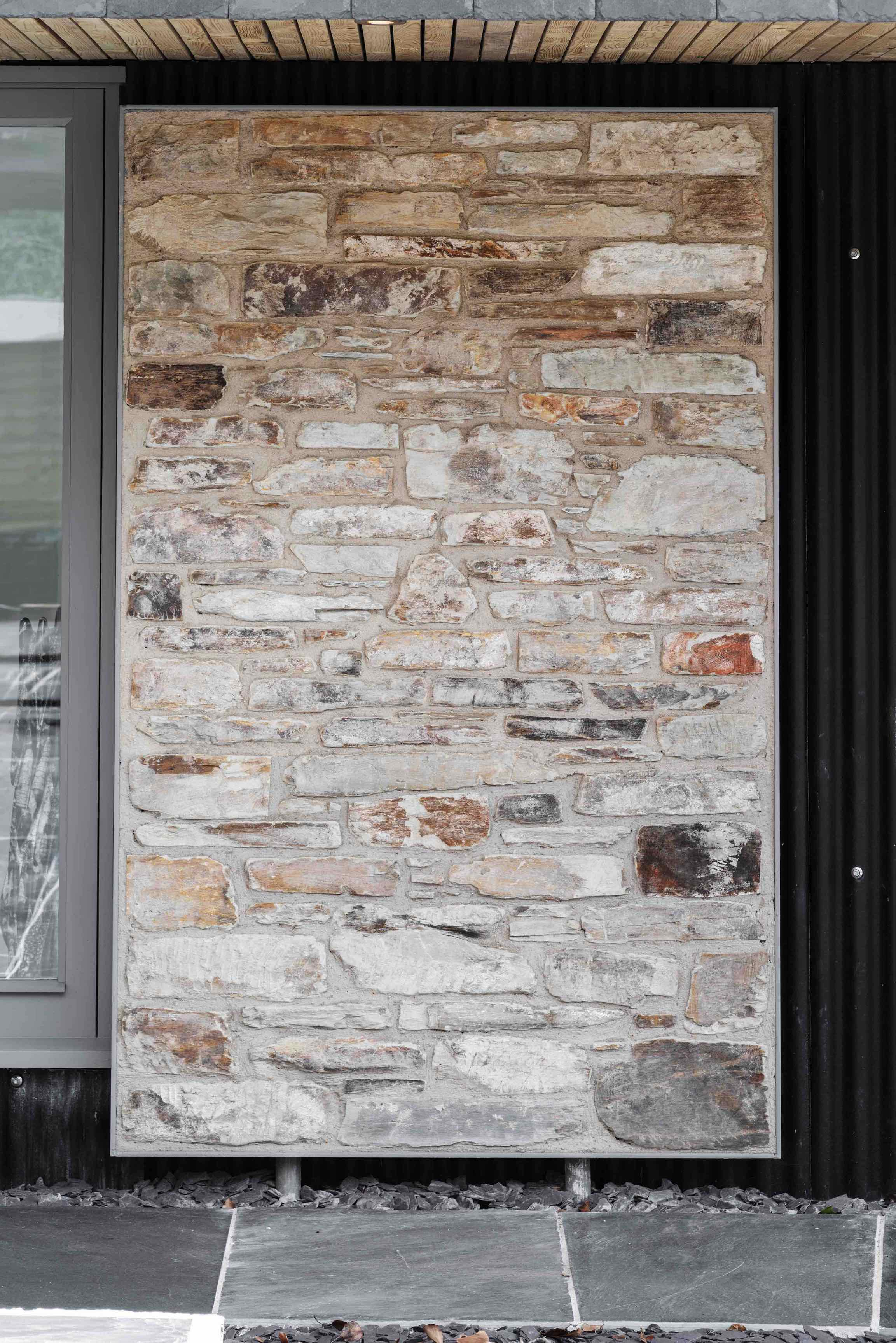 stone panel set in steel frame