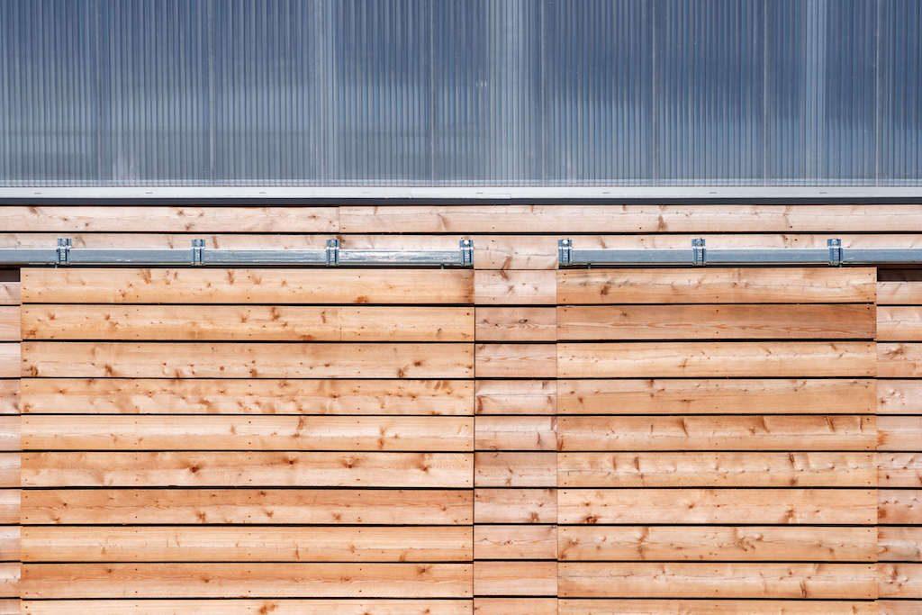 Sliding timber board doors